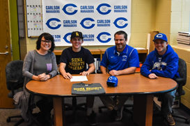 Jaden Payne on signing day with Siena Heights