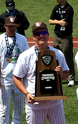Pat Lancaster holds up the 2013 MAC Championship Trophy